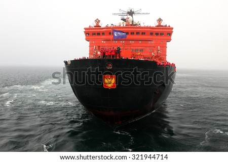 ARCTIC OCEAN, RUSSIA - July 11, 2015: Arctic cruise on board of nuclear icebreaker â??50 years of Victoryâ? â?? the biggest icebreaker in the world.  - stock photo