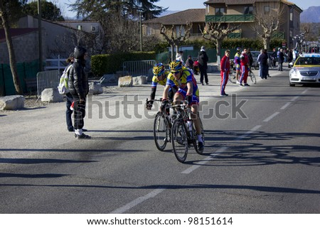 ARDECHE, FRANCE - FEB 26: Peter Kusztor and Jonathan Fumeaux in the UCI Europ Tour les Boucles du Sud Ard�¨che. Remi Pauriol wins the race on February 26, 2012 in Sampzon Rock, Ardeche, France. - stock photo