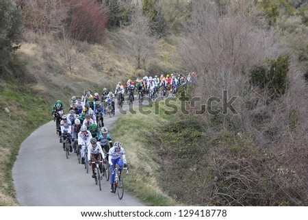 "ARDECHE, FRANCE - FEB 24: Professional racing cyclists pack riding UCI Europ TOUR ""LES BOUCLES DU SUD ARDECHE"". Matthieu Drujon wins the race on February 24, 2013 in Sampzon Rock, Ardeche, France. - stock photo"