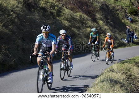 """ARDECHE, FRANCE - FEB 26: Professional racing cyclists race in the UCI Europ TOUR """"LES BOUCLES DU SUD ARDECHE"""". Remi Pauriol wins the race on February 26, 2012 in Sampzon Rock, Ardeche, France. - stock photo"""