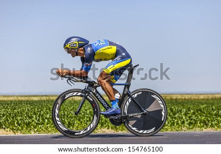 ARDEVON,FRANCE-JUL 10: The Italian cyclist Daniele Bennati from Team Saxo-Tinkoff cycling during the stage 11(time trial Avranches -Mont Saint Michel) of Le Tour de France on July 10, 2013 - stock photo