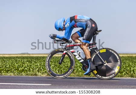 ARDEVON,FRANCE-JUL 10:The Scottish cyclist David Millar from Garmin-Sharp Team cycling during the stage 11 (time trial Avranches -Mont Saint Michel) of Le Tour de France on July 10, 2013 - stock photo