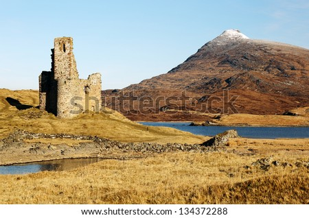 Ardvreck Castle ruin and the snow capped mountain Quinag. Assynt, Scotland - stock photo