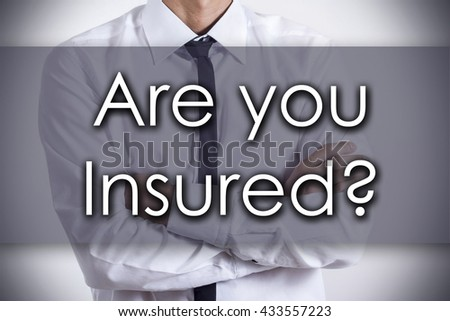 Are you Insured? - Closeup of a young businessman with text - business concept - horizontal image