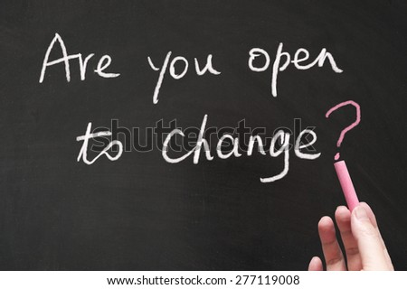 Are you open to change words written on the blackboard using chalk - stock photo