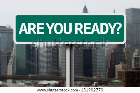 Are you read? road sign and a business city in the background  - stock photo