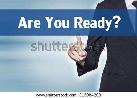 Are You Ready Business woman pointing at word for business background concept - stock photo