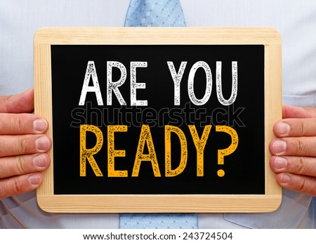 Are you ready ? - Businessman with blackboard - stock photo