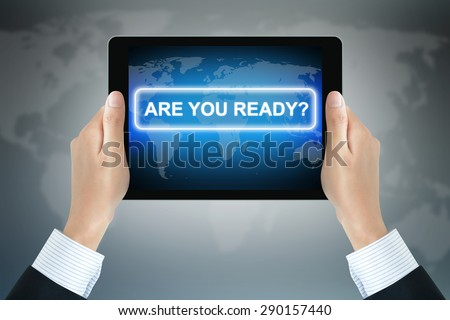 ARE YOU READY? message on tablet pc screen held by businessman hands - stock photo