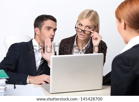 Are you sure she is right candidate? Two attractive young business people interviewing a job candidate - stock photo