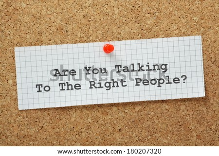 Are You Talking to The Right People typed on a piece of graph paper and pinned to a cork notice board. It is important in negotiations and planning to engage the people who can make things happen - stock photo