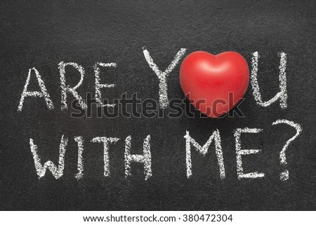 are you with me question  handwritten on chalkboard with heart symbol instead of O