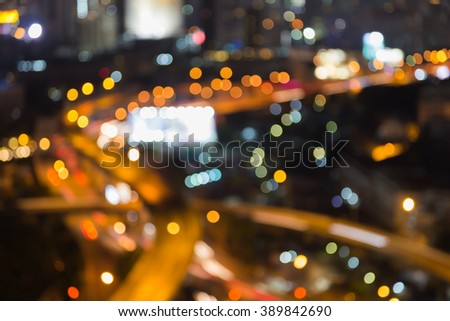 Areal view freeway intersection night, abstract blurred bokeh lights background - stock photo