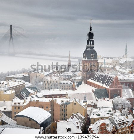 Areal view on Riga cityscape in fog, Latvia - stock photo