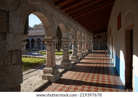 AREQUIPA, PERU - AUGUST 25, 2014:Cloisters around a secluded courtyard in the historic Monasterio de la Recoleta in Arequipa, Peru. - stock photo