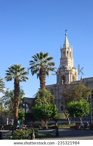 AREQUIPA, PERU - OCTOBER 8, 2014: Plaza de Armas and the Basilica Cathedral in the city center in the morning on October 8, 2014 in Arequipa, Peru. Arequipa is an UNESCO World Cultural Heritage Site.  - stock photo