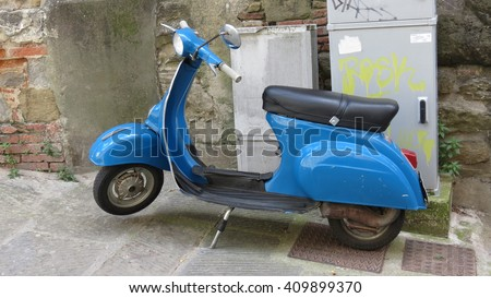 AREZZO, ITALY - CIRCA APRIL 2016: Italian Vespa scooter dating back to the 1960s parked on the street - stock photo