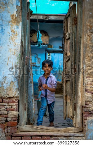 ARGA, INDIA - MARCH 19, 2016: Boy posing in the doorway of his house on March 19, 2016.