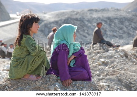 ARGAH QESHLAQ / AFGHANISTAN - NOVEMBER 22: Two unidentified young girls watch a Buzkashi match in the village of Argah Qeshlaq in the far north east of Afghanistan on November 22, 2012