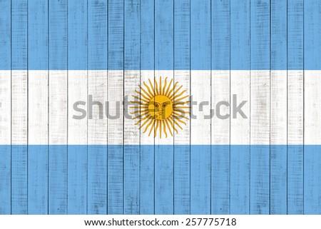 Argentina Flag on wood background - stock photo