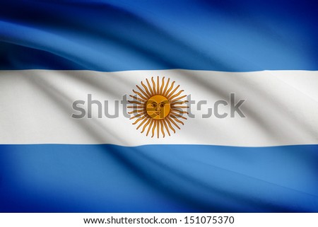 Argentinean flag blowing in the wind. Part of a series. - stock photo