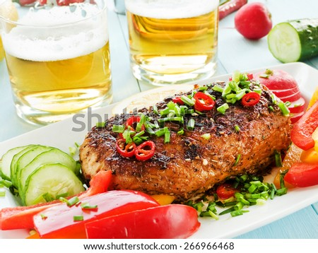 Argentinian Asado pork fillet with herbs, veggies and sauce. Shallow dof. - stock photo