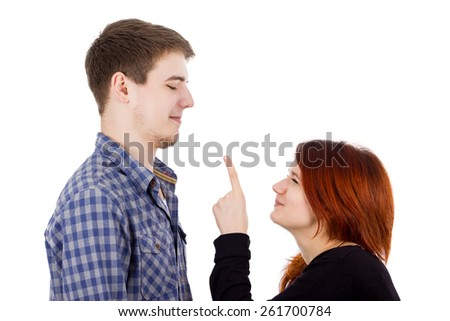 Arguing Young women pointing to a young men isolated over white background. - stock photo