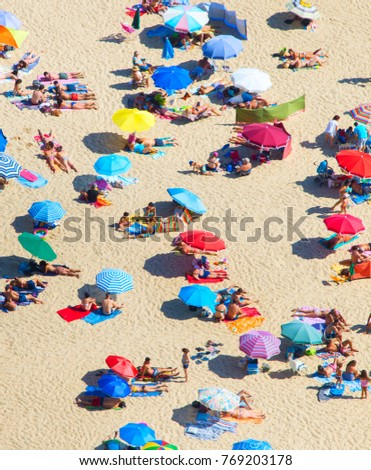 Arial view of a crowded beach in a hot sunny summer day