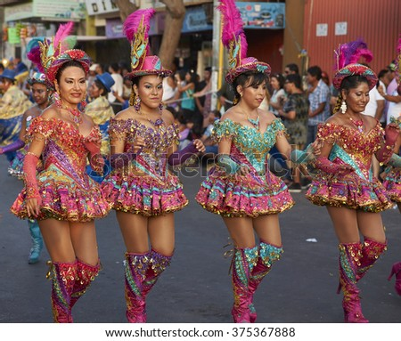 ARICA, CHILE - JANUARY 24, 2016: Morenada dancers in traditional Andean costume performing at the annual Carnaval Andino con la Fuerza del Sol in Arica, Chile.