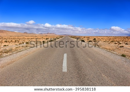 Arid empty desert road  in the Middle Atlas Mountains in Morocco, Africa