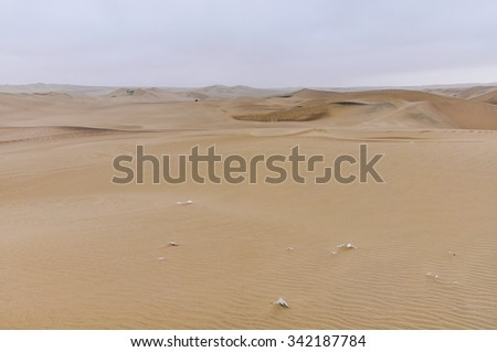 Arid landscape around Huacachina in the coastal desert of Peru - stock photo