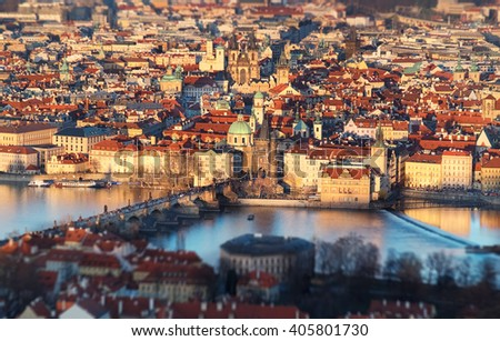 Arieal view of Old Prague with Charles Bridge crossing the river late in the afternoon. Shallow DOF, tilt-shift effect with parts of image out of focus. This image is toned.  - stock photo