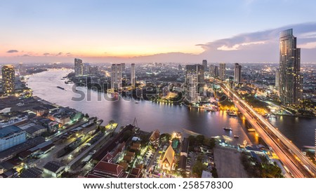 Ariel view of downtown Bangkok skyline from roof top at sunset - stock photo