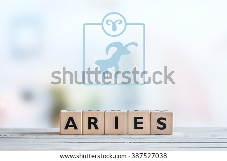 Aries star sign on a wooden table - stock photo