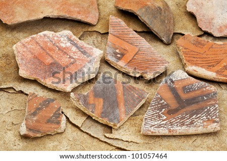 Arizona Anasazi pottery shards, ancient Native American Indian artifacts, several fragments of a bowl,  on a sandstone background - stock photo