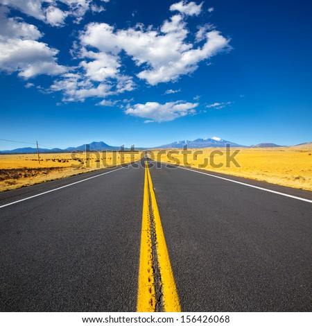 Arizona Highway 89 US with view of snowed mountains in Humphreys peak near Flagstaff - stock photo
