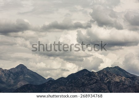 Arizona mountains under thick clouds in wilderness - stock photo