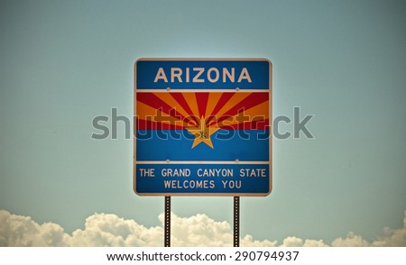 Arizona The Grand Canyon state traffic welcome sign on the border entrance color processed instagram desaturated photo