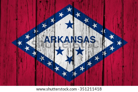 Arkansas state grunge wood background with Arkansan flag painted on aged wooden wall.