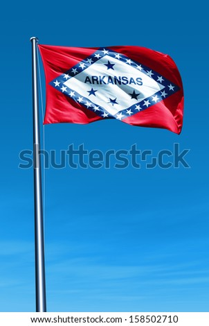 Arkansas (USA) flag waving on the wind - stock photo