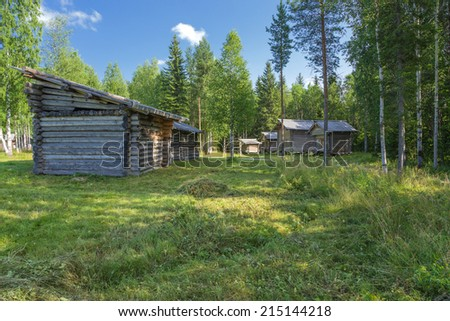 ARKHANGELSK, RUSSIA - AUG 1, 2013: Photo of the Barns and other farm building, XIX century. Arkhangelsk State Museum of Wooden Architecture and Folk Art Mallye Korely  - stock photo