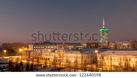 Arkhangelsk, Russian northern city. Solovetsky monastic metochion and skyscraper building view. - stock photo