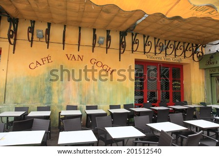 ARLES, FRANCE - JAN 23, 2013: View of Cafe Van Gogh on Jan 23, 2013 in Arles, France.  This is the same Cafe Terrace that Vincent van Gogh painted in 1888 and is now a landmark tourist attraction. - stock photo