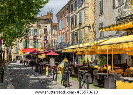 Arles, France on the 10th June 2016: The Place du Forum, is where the Dutch artist Vincent Van Gogh painted the Cafe Terrace at Night painting and is now a major tourist location in Arles France