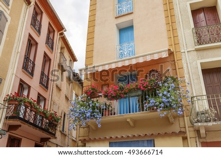 ARLES-SUR-TECH,FRANCE-JULY 24,2014: Colored houses in french village of Arles-sur-Tech, Languedoc-Roussillon, France.