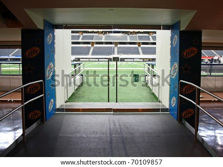 ARLINGTON - JAN 26: A view of the player entrance to the field through the Miller Lite Club in Cowboys Stadium in Arlington, Texas - sight of Super Bowl XLV. Taken January 26, 2011 in Arlington, TX. - stock photo