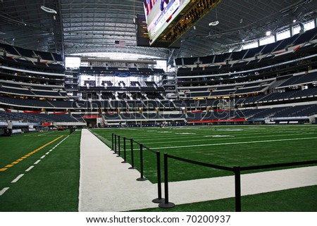 ARLINGTON - JAN 26: A view of the side line and field in Cowboys Stadium in Arlington, Texas sight of Packers Steelers Super Bowl XLV. Taken January 26, 2011 in Arlington, TX. - stock photo