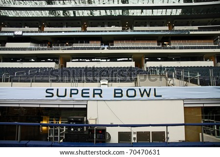 ARLINGTON - JAN 26: A view of the stands and a broadcast area set for Packers Steelers Super Bowl XLV in Cowboys Stadium in Arlington, Texas. Taken January 26, 2011 in Arlington, TX. - stock photo