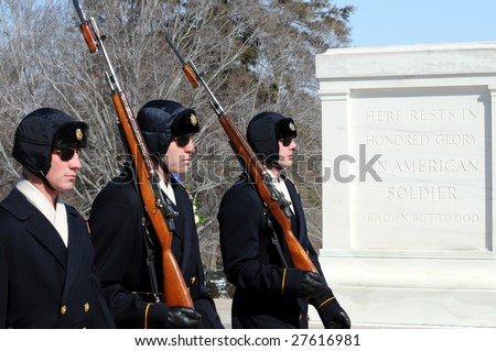 ARLINGTON - March 3: Changing of the guards on a winter day on March 3 2009 at the Tomb of the Unknown Soldier at the Arlington National Cemetery in Virginia. - stock photo