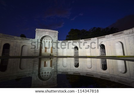 Arlington National Cemetery entrance at night with mirror reflection on the pool, near to Washington DC - stock photo